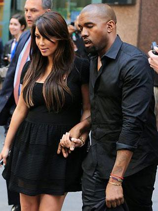 News Kim Kardashian lifestyle pregnancy in red photo dress 2