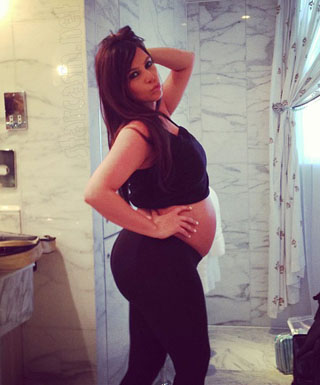 News Kim Kardashian lifestyle pregnancy in red photo dress 3